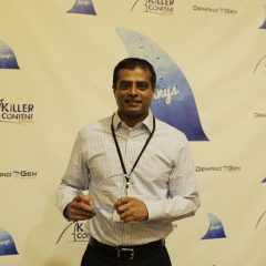Arun Gowda, VP, Business Development, Vormetric poses with his KCA Award for Influencer Content.