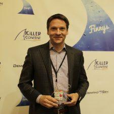 Chris Golec, CEO, Demandbase shows off his Account-Based Marketing KCA Award.