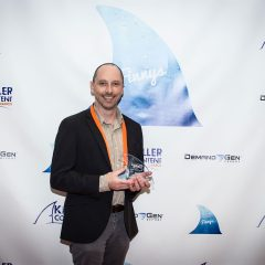 Colman Murphy of Xerox accepting the Multi-Touch Campaign Finny.
