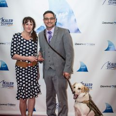 Samantha Epstein of K9s for Warriors and Randy Dexter, a Combat Veteran along with his adorable service dog Captain, accepting their Finny award.