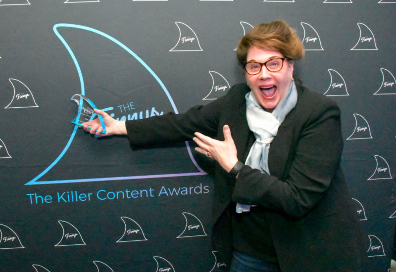 Jeanne Hopkins proudly showed off Lola.com's Finny for Best Audio Content.