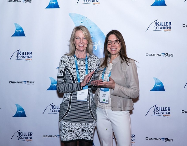 Cindy Bagley and Eileen Rivera of Ciox Health accept the Finny award for the Measurable ROI category.