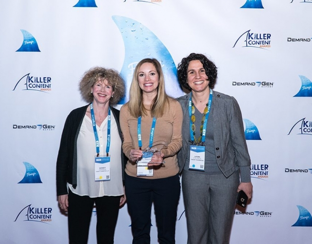 Wendy Anderson, Katie Doyle and Laura Stef-Praun of Grant Thornton accept a Killer Content Award for the Bundled Content category.