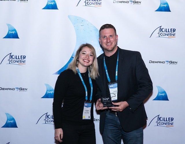 Tatiana Natzke of Social Tribe and Ryan Sonnenberg of SAP accept the Finny award for the Video Content category.