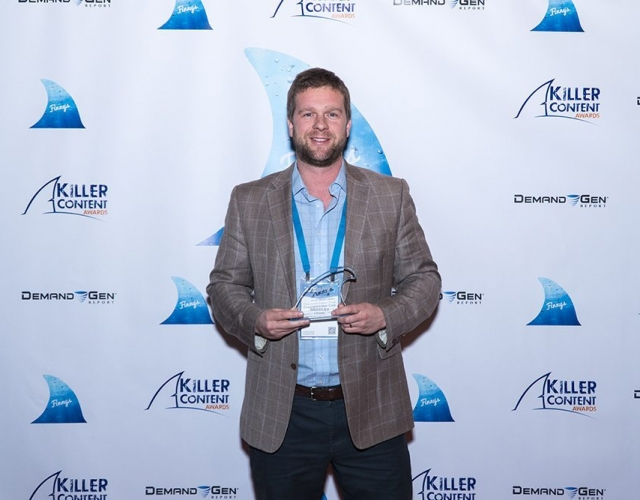 Bradley Hearn of ChannelAdvisor accepts the Finny award for the Account-Based Marketing Campaign category.